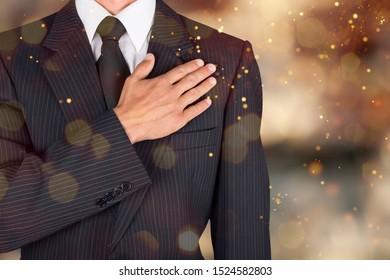 Patriot businessman, citizen holding palm on heart