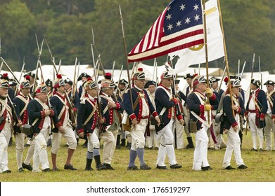 Patriot soldiers march to Surrender Field as part of the 225th Anniversary of the Victory at Yorktown, a Revolutionary reenactment Virginia, Revolutionary War.