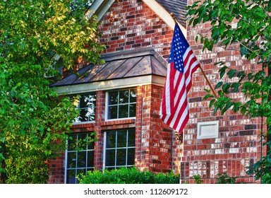 Patriotic American flag in front of southern home