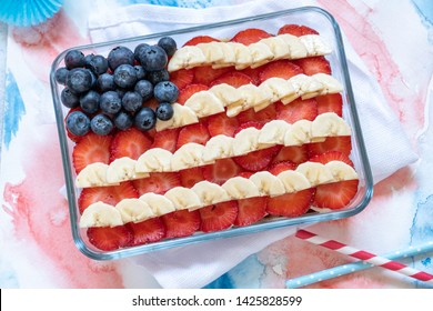 Patriotic American flag fruit berry dessert with banana, blueberries and strawberries