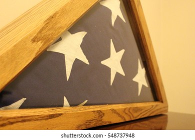 Patriotic American military retirement flag in wooden case