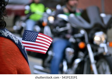 Patriotic American Watches as Motorcycles Pass in Parade