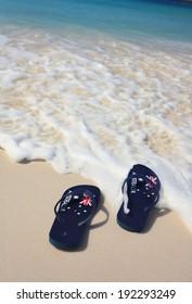Patriotic Aussie thongs featuring Australian flag on the beach.