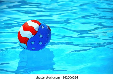 patriotic beach ball in a swimming pool