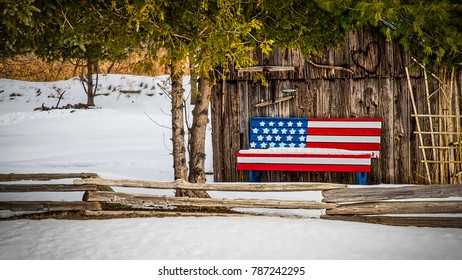 A patriotic bench sits against a shack in the Wisconsin countryside.