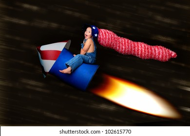 Patriotic Blast Off:  adorable young boy in a stars and stripes hat clings to a rocket as it speeds through the night sky