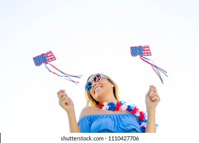 A patriotic blonde model having fun during the 4th of July holiday.