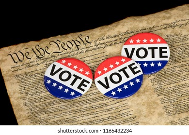 patriotic campaign voting pins on vintage United States Constitution document