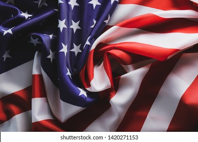Patriotic composition w/ ruffled American flag on black background. United States of America stars & stripes symbol with copy space for text. 4th of july Independence day concept. Background, close up