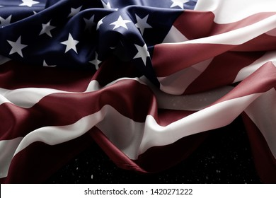 Patriotic composition w/ ruffled American flag on wood planks background. United States of America stars & stripes symbol with copy space. 4th of july Independence day concept. Background, close up
