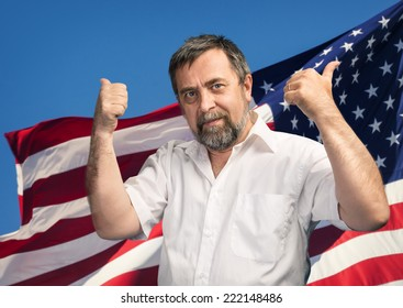 Patriotic concept. Man with thumbs up sign against United States of America flag
