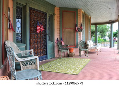 patriotic front porch display with american flags