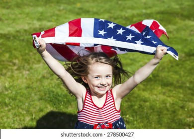 Patriotic holiday  child with American flag running. 4th of july