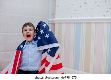 Patriotic Holiday. Happy kid, cute little Child  Boy with American flag.  America Celebrate 4th of July