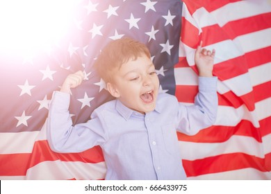 Patriotic holiday. Silhouettes of people holding the Flag of USA. America celebrate 4th of July. Fourth of July Independence Day in the United States, the holiday and the flag of America