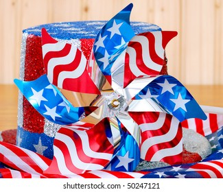 patriotic pinwheel and glitter covered hat on patriotic fabric.  Good for elections, Memorial Day, Fourth of July, Veterans Day, etc . . .