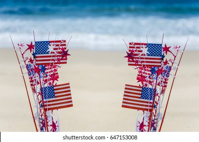 Patriotic USA background with american flags decorations on the sandy beach