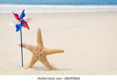 Patriotic USA background with starfishes and decorations on the sandy beach