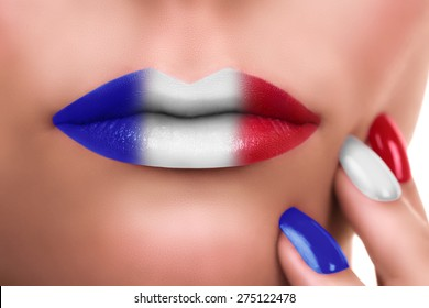 Patriotic woman lips with lipstick makeup and nail polish in red white blue color. Make up manicure.