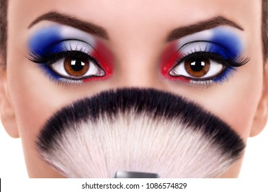 Patriotic young woman wearing fun artistic red white and blue color eye shadow party make up for labor day, vote, July, independence, memorial or sale. Creative beauty fashion artist eyeshadow makeup.