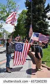 Patriots waving American Flags at the Act for America Rally in Denver, Colorado on June 10, 2017.