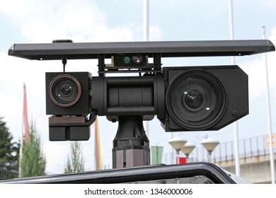 Patrol Vehicle Mounted Surveillance CCTV Camera Lens at Pole