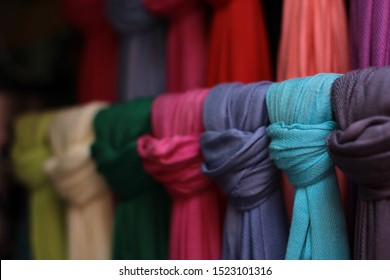 Patron of color scarfs in cloth