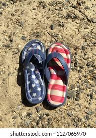 Patrotic flip flops on beach