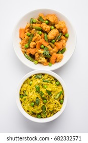 Patta Gobi and Phoob Gobhi Sabji also known as Cabbage  / Cauliflower sabzi with green peas, served in two white bowls, selective focus