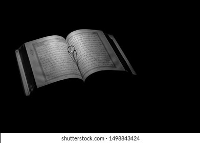 Pattani , Thailand - 12 Jun 2019 : Beautiful silver rings on Holy Al-Quran in black and white tint