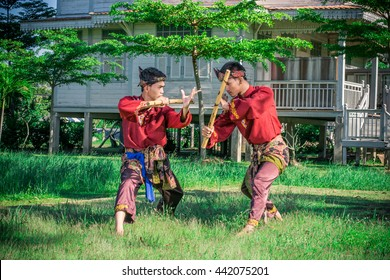 Pattani, Thailand - 23 June 2016 : two young boy performing a pencak silat, Malay traditional discipline martial art.