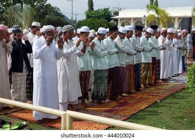 Pattani Thailand - June 08, 2015 : men praying in the historic pattani Masjid mosque