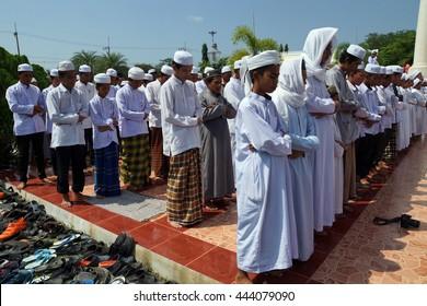 Pattani Thailand - June 18, 2014 : men praying in the historic pattani Masjid mosque