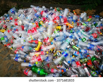 PATTANI, THAILAND-APRIL 16, 2018:Used aluminium can and plastic bottle on the ground.It's rubbish ready to be sent to the factory for recycle.