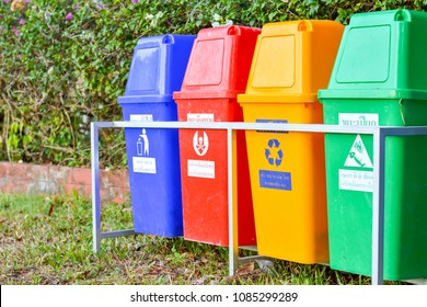 PATTANI,THAILAND-MAY 02, 2018: Varieties of colors fiber bins on iron rail in park.Bins for various types of waste, General,Hazardous,recycle waste and garbage.To be easy to eliminate.