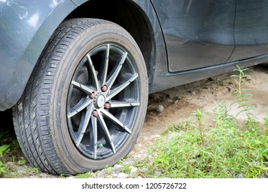 PATTANI,THAILAND-OCTOBER 18,2018: Car's flat tire caused by the nail punctured.Emergency issues during the trip.