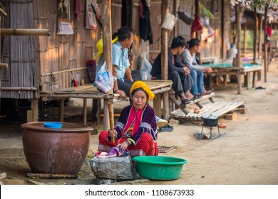 Pattaya, Chonburi Province / Thailand - 01.17.2018: woman from the tribe washes clothes in traditional village -  Moo Baan Chon Pao.