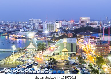 Pattaya - Holiday Nights : Pattaya City twilight time, busy with cars and people on January 18th, 2014