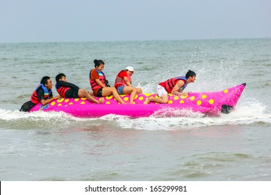 PATTAYA  - November 16 : Tourists enjoying ride a Banana Boat adventure on November 16, 2013 in Pattaya beach,Thailand