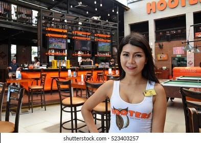 PATTAYA, THAILAND - 22 NOV, 2016: Hooters girl poses for photo in Hooters restaurant in Pattaya, Thailand