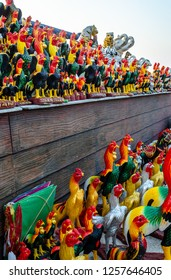 PATTAYA THAILAND 8 December 2018 : Chicken ornaments for offring to gain goodluck as Thai words say : lucrative, wealthy, affluent, prosperous, well-to-do