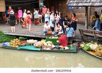 PATTAYA, THAILAND - APRIL 01, 2018: Tourist shopping and Scenic boat ride in Pattaya Floating Market. One of the famous tourist attraction in Pattaya city, Thailand.