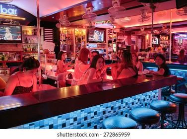 PATTAYA, THAILAND - APRIL 4, 2015: Girls in a night club