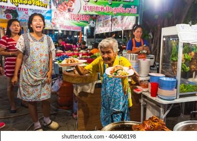 PATTAYA, THAILAND - APRIL 4, 2015; traders at the night market in Thailand