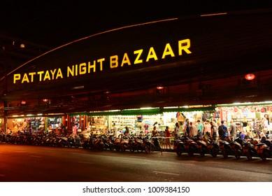 Pattaya, Thailand - Aug 24, 2017 - Foreign tourist buys some Thai handicraft souvenirs at market in Pattaya