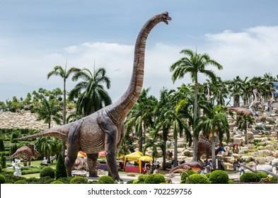 PATTAYA, THAILAND - AUGUST 13, 2017 : People visit dinosaur Valley at Nong Nooch Garden Pattaya, Thailand