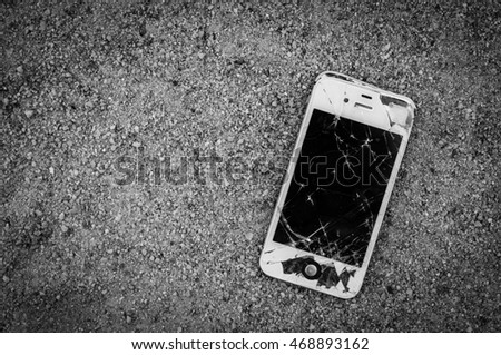 Pattaya, Thailand - August 15, 2016 Photo of a damaged iPhone 4s on cement floor. iPhone 4s is a smartphone developed by Apple Inc.