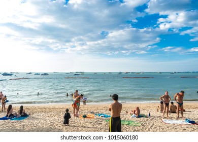 Pattaya, Thailand - December 31, 2017: Unidentified people walk, do outdoor activity and enjoy on the beach of  Pattaya Jomtien Beach during the new year's eve.