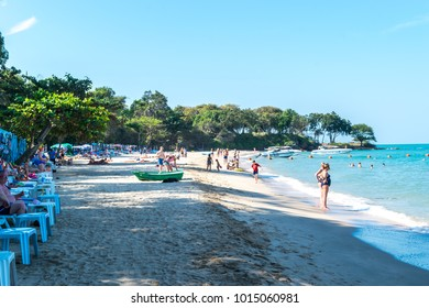 Pattaya, Thailand - December 31, 2017: Unidentified people walk, do outdoor activity and enjoy on the beach of  Pattaya Cozy beach during the new year's eve.
