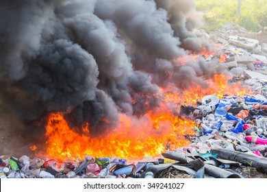 PATTAYA, THAILAND - DECEMBER 9 : Burning garbage heap of smoke from a burning pile of garbage on December 9, 2015 in Pattaya, Thailand.